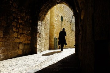 An Hasidic Jew walks through an Archway in the Jewish Quarter of the Old City in Jerusalem.